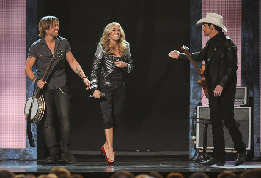 NASHVILLE, TN - NOVEMBER 10:  Keith Urban, Brad Paisley and Carrie Underwood perform onstage at the 44th Annual CMA Awards at the Bridgestone Arena on November 10, 2010 in Nashville, Tennessee.  (Photo by Rick Diamond/Getty Images)