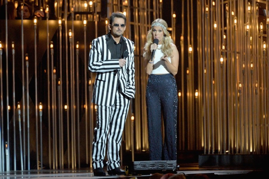 NASHVILLE, TN - NOVEMBER 06:  Hosts Brad Paisley (L) and Carrie Underwood speak onstage during the 47th annual CMA awards at the Bridgestone Arena on November 6, 2013 in Nashville, United States.  (Photo by Rick Diamond/Getty Images)