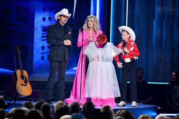 (L-R) Brad Paisley, Carrie Underwood and Mason Ramsey perform onstage during the 52nd annual CMA Awards at the Bridgestone Arena on November 14, 2018 in Nashville, Tennessee.  (Photo by Michael Loccisano/Getty Images)