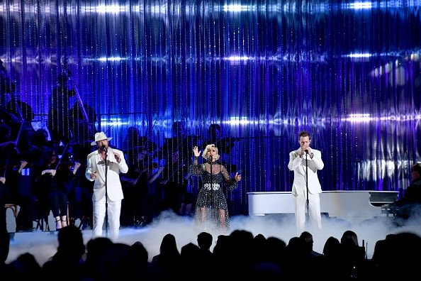 Bebe Rexha (C) performs with Brian Kelley and Tyler Hubbard of Florida Georiga Line onstage during the 52nd annual CMA Awards at the Bridgestone Arena on November 14, 2018 in Nashville, Tennessee.  (Photo by Michael Loccisano/Getty Images)