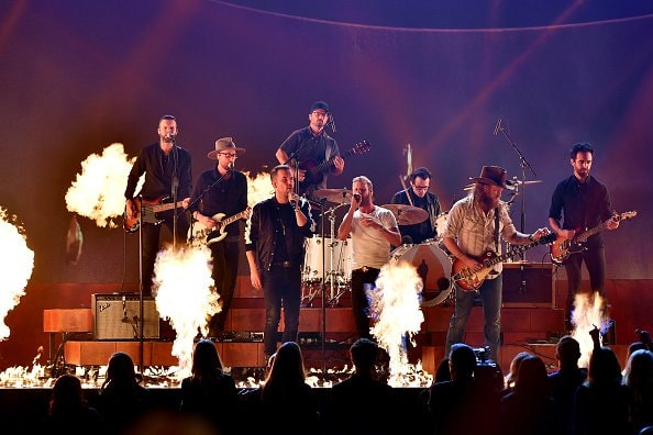 TJ Osborne and John Osborne of Brothers Osborne perform onstage with  Dierks Bentley during the 52nd annual CMA Awards at the Bridgestone Arena on November 14, 2018 in Nashville, Tennessee.  (Photo by Michael Loccisano/Getty Images)