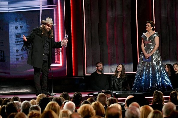 Martina McBride presents Chris Stapleton with award onstage during the 52nd annual CMA Awards at the Bridgestone Arena on November 14, 2018 in Nashville, Tennessee.  (Photo by Michael Loccisano/Getty Images)