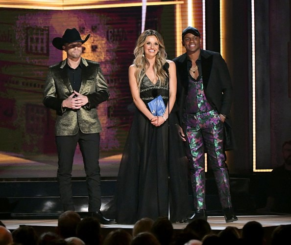 (L-R) Dustin Lynch, Carly Pearce and Jimmie Allen perform speak onstage during the 52nd annual CMA Awards at the Bridgestone Arena on November 14, 2018 in Nashville, Tennessee.  (Photo by Michael Loccisano/Getty Images)