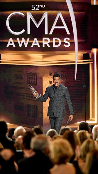Singer-songwriter Lionel Richie presents award onstage during the 52nd annual CMA Awards at the Bridgestone Arena on November 14, 2018 in Nashville, Tennessee.  (Photo by Michael Loccisano/Getty Images)