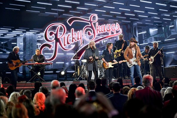 Ricky Skaggs, Keith Urban, and John Osborne of the Osborne Brothers performs onstage during the 52nd annual CMA Awards at the Bridgestone Arena on November 14, 2018 in Nashville, Tennessee.  (Photo by Michael Loccisano/Getty Images)