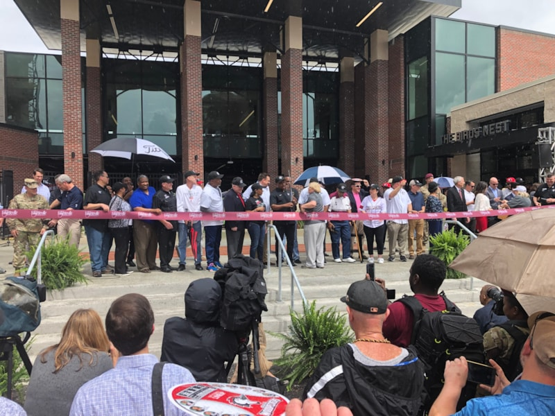 Dignitaries cut the ribbon to open Segra Stadium, home of the Fayetteville Woodpeckers.