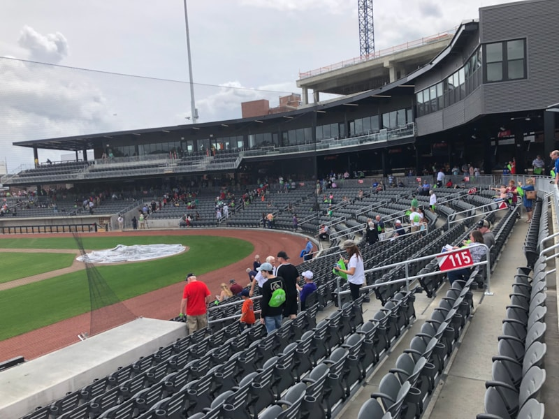 The club level suites overhang the seats behind home and toward first base.