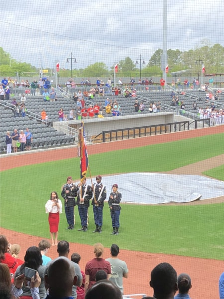 The national anthem is presented at Segra Stadium, home of the Fayetteville Woodpeckers.