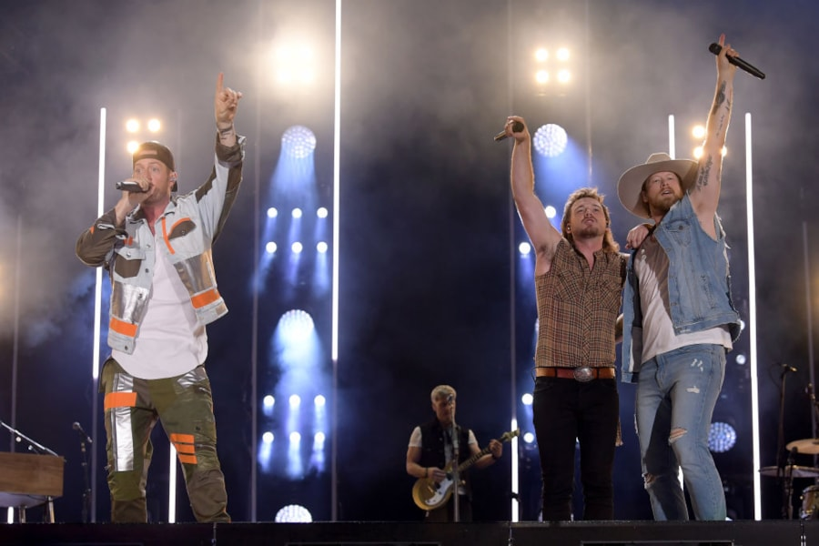 Tyler Hubbard and Brian Kelley of Florida Georgia Line and Morgan Wallen perform on stage during day 1 of 2019 CMA Music Festival.