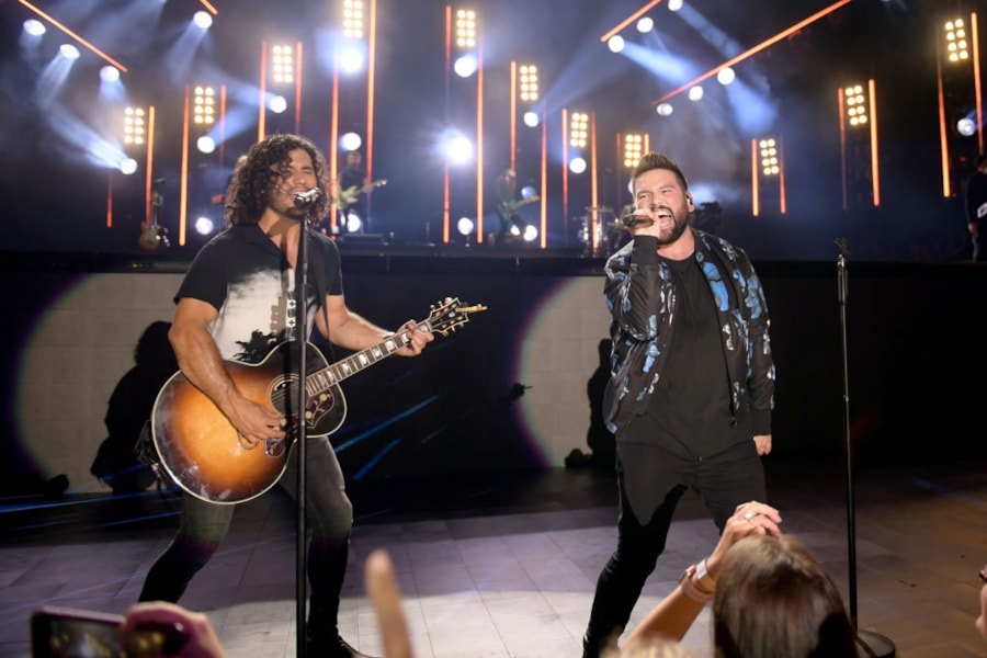 Dan Smyers and Shay Mooney of Dan + Shay perform on stage during day 2 for the 2019 CMA Music Festival.
